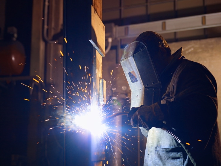 Man at work as welder in heavy industry